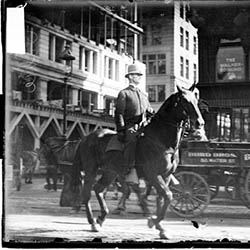 Mounted policeman riding a horse on a street in the Loop